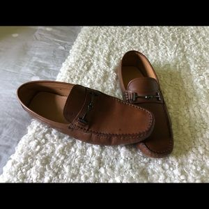 Tods driving loafers